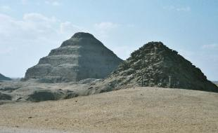 View of Saqqara necropolis, including Djoser's step pyramid (centre), the Pyramid of Unas (left), and the Pyramid of Userkaf (right). (Photo via Wikipedia.)